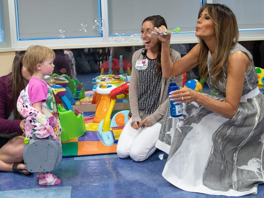 Melania Trump blows bubbles with 18-month-old patient