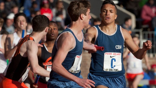 CBA's Christian McLaughlin hands off to Blaise Ferro during their third place worthy Distance Medley Relay Friday at Penn Relays in Philadelphia Pa. on April 24, 2015. Peter Ackerman/Staff Photographer