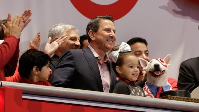 Target Corp. Chairman and CEO Brian Cornell is applauded as he and company mascot bulldog Bullseye ring the New York Stock Exchange opening bell Friday.