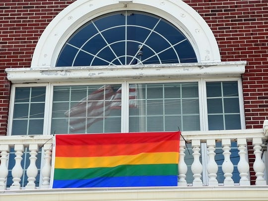 The LGBT Pride flag hangs in front of Westwood borough