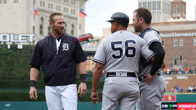 Tigers' Andrew Romine, left, talks to his brother Austin Romine following Thursday's benches-clearing brawl in the sixth inning.