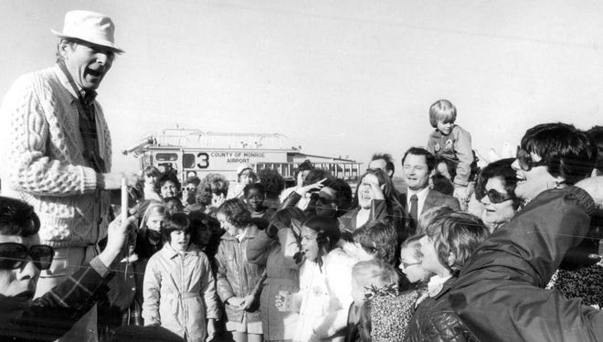 Comedian Danny Kaye charmed a crowd of kids with some funny faces while at the airport on October 29, 1975.