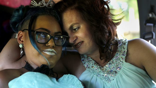 Jerika Bolen and her mother, Jen, enjoy a quiet moment before the special prom held in August. Jerika died Thursday morning.