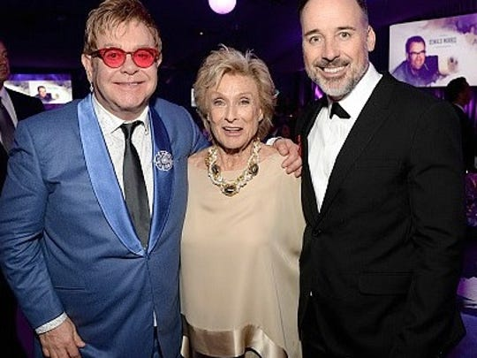Cloris Leachman poses with Elton John.