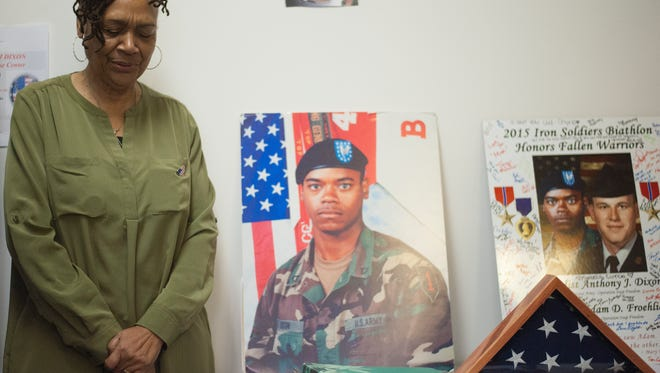 Gold Star mother Jacquelyn Dixon stands during an opening ceremony of the AJ  Dixon Vets & Friends Center.