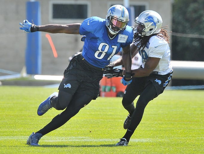 Wide receiver Calvin Johnson works with Troy rookie