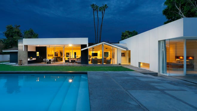 The backyard of Laura and Jeff Beraznik's home, Wednesday, Aug. 20, 2014 in Phoenix, Arizona. The Beraznik's wanted a thoroughly modern home, but they were also passionate about honoring the character of the 1950s ranch. They hired architect Brent Kendle to remodel their Arcadia ranch home.