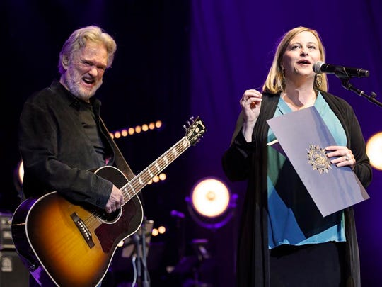 Kris Kristofferson reacts as Nashville Mayor Megan Barry reads a proclamation that today is Kris Kristofferson Day in Nashville at The Life and Songs of Kris Kristofferson at Bridgestone Arena on Wednesday.