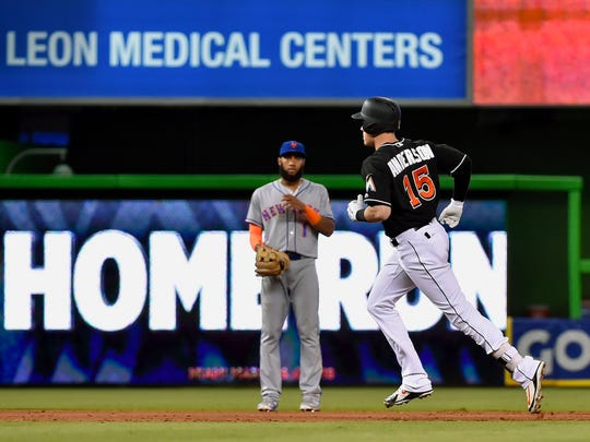 Jun 30, 2018; Miami, FL, USA; Miami Marlins left fielder Brian Anderson (15) rounds the bases after hitting a two run home run in the sixth inning against the New York Mets at Marlins Park.