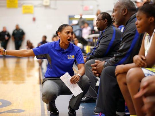 Rickards' Head Coach Chariya Davis talks to her team