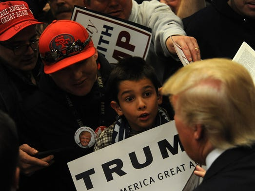 Republican candidate for President Donald Trump greets