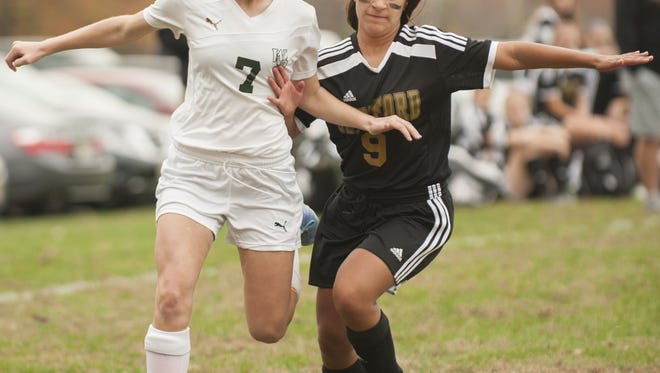 West Deptford's Emma Blades (left) and Gaby Gonzalez battle for the ball during the first half of Monday's South Jersey Group 2 playoff game.