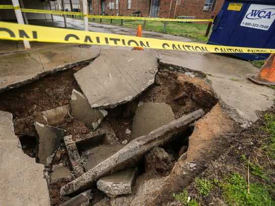 A trash truck fell into a hole after the concrete collapsed