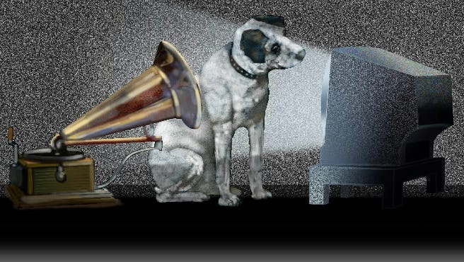 Nipper the RCA dog is listening to his master's voice while he also watches TV.