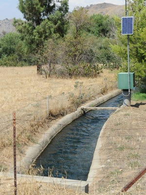 Water bound for farms flows through a ditch near Lake Success in Tulare County in July.