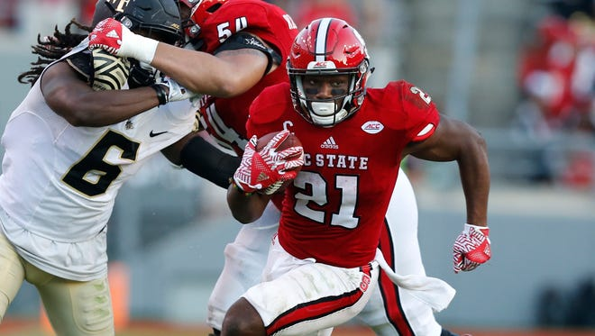 North Carolina State running back Matt Dayes (21) gains yards against Wake Forest in Raleigh, N.C., on Oct. 1, 2016.