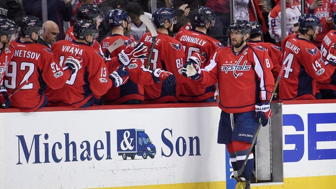 Washington Capitals left wing Alex Ovechkin (8), of Russia, celebrates his goal during the second period of an NHL hockey game Minnesota Wild, Tuesday, March 14, 2017, in Washington.