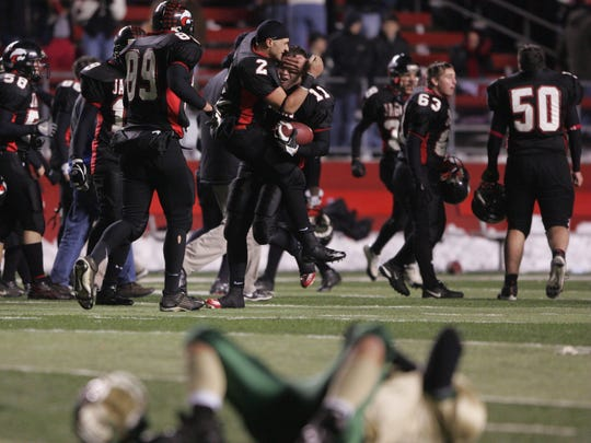 Jackson Memorial players celebrate theri last-second victory in the 2005 Central Group IV final in front of a Brick Memorial player at Rutgers.