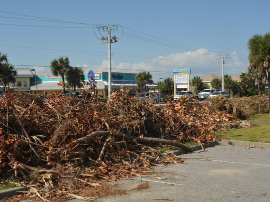 Yard waste lined roadsides throughout Brevard County after Hurricane Matthew.