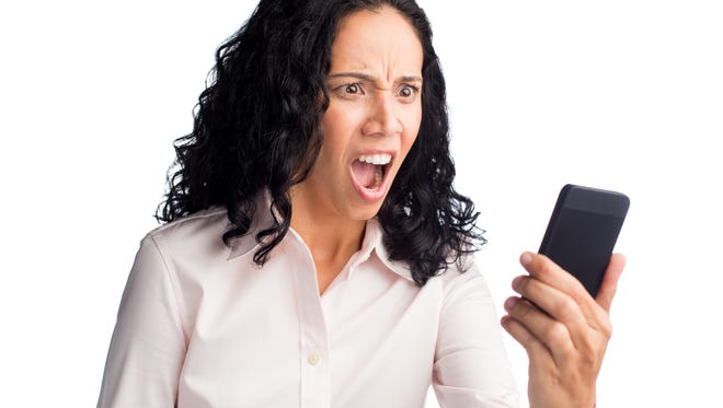 Close-up of a woman seeing something on her phone.