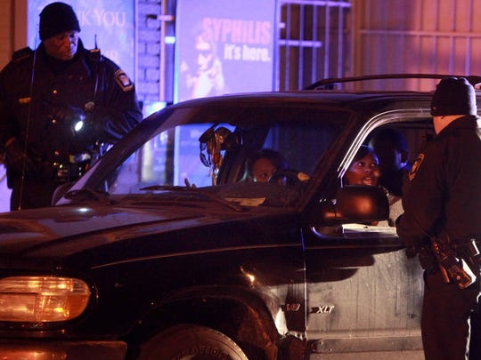 Cincinnati Police Officer Dwight Pewett, left, shown