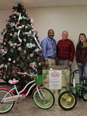 (From left) SSG (R) James Merritt, LTC (R) Al Flood, and junior JROTC student Jess Jacobs, a junior and a member of Delsea's JROTC, are pictured with donations received for Delsea Regional High School JROTC's annual Toys for Tots Campaign.