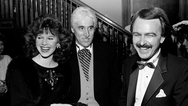 Lorianne Crook, left, her composing-producing husband, Jim Owens, and her TV co-host, Charlie Chase, laugh during the annual SESAC banquet at Union Station on Oct. 15, 1987. All three were award winners at the event.