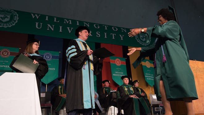 Jack Varsalona, Ed.D., President hands out diplomas at Wilmington University commencement ceremony at the William A. Carter Partnership Center at Delaware Technical Community College in Georgetown where 229 graduates took part.