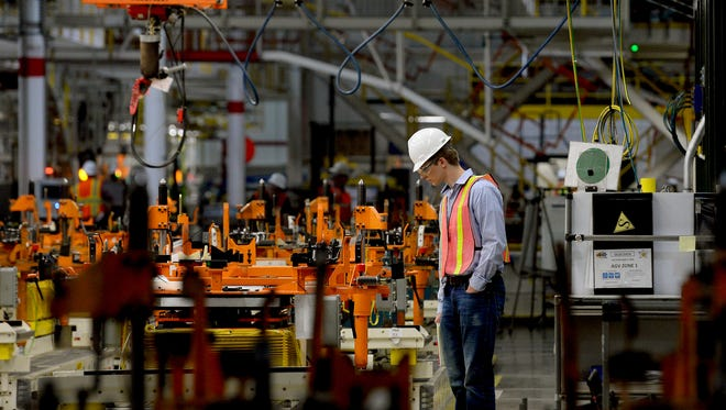 Patrick Beal, a manufacturing engineering intern, looks at the monitors at the GM Delta Township plant on June 2, 2016. The plant was closed all of May for work on a $583-million investment to expand and install new tooling and equipment.