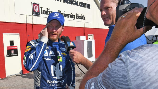 Dale Earnhardt Jr. is interviewed outside the Indiana University Health Emergency Medical Center after he was knocked out of the Brickyard 400 at Indianapolis Motor Speedway on Sunday, July 23, 2017.