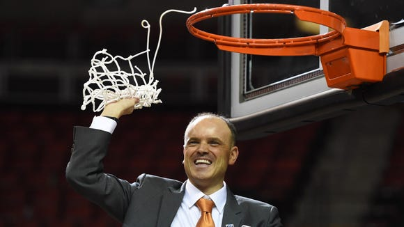 Oregon State women's basketball coach Scott Rueck, celebrates after the Beavers' victory over UCLA in the Pac-12 tournament championship game.