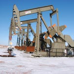This Feb. 26, 2015 photo, shows an oil well on the Fort Berthold Indian Reservation near Mandaree, North Dakota. U.S. officials announced plans Thursday, July 28, 2016, to speed up permitting for oil and gas drilling on federal and American Indian lands to reduce delays, as applications were projected to be down amid an ongoing price slump.