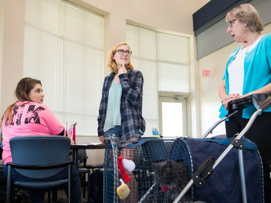 From left Pellissippi State Community College students Summer Kirkland and Maggie Potter talk to counselor Betsy Boyd in the library as she pushes her cat Jimmy Carter McGill in a stroller at the Blount County campus on Wednesday, April 26, 2017. Boyd started bringing Jimmy to work with her about a year ago, and the two are the inspiration behind Pellissippi State making all five of its campusÕ Habit facilities where animals can visit with students and staff anytime as a stress reliever.