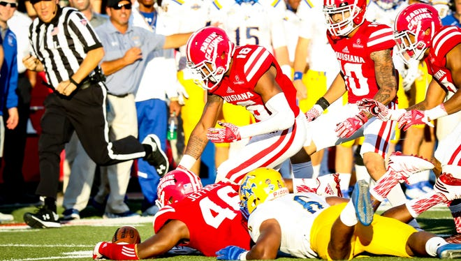 Juco-transfer defensive end Jarvis Jeffries recovers a fumble in UL's 30-22 win over McNeese State earlier this season.