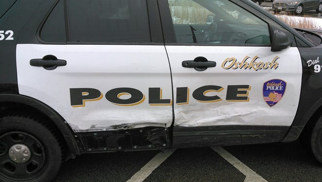 Oshkosh Police say a stolen car rammed a department squad on Friday. This photo released on Tuesday shows damage to the vehicle.