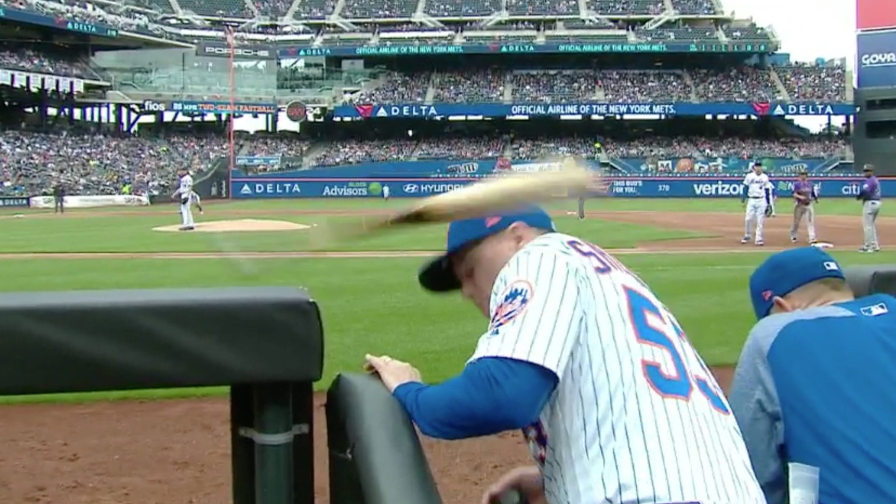 Softball C Screen : Mets coach gets hit by bat in the dugout laughs