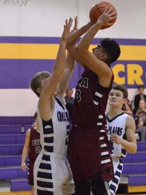 Eula's Joshua Smith puts a third-quarter shot up over Cross Plains' Bryce Petree (left) while Creed Goode (right) converges on the play in Tuesday's game at Cross Plains.