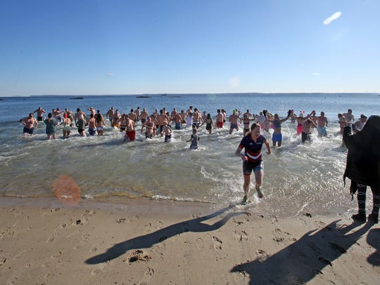 Locals participate in the 16th annual polar bear plunge