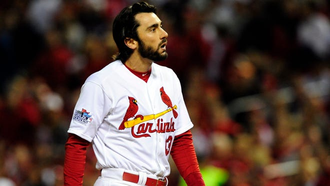 Cardinals second baseman Matt Carpenter  reacts after he was called out on strikes against the Red Sox during the third inning of Game 5 at Busch Stadium.