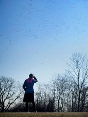 Esther Riddle, of Clay, watches thousands of waterfowl