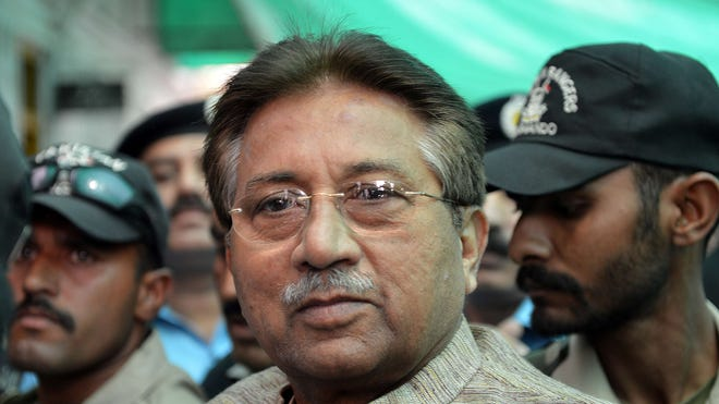 Former Pakistani president Pervez Musharraf is escorted by soldiers as he arrives at an anti-terrorism court in Islamabad.