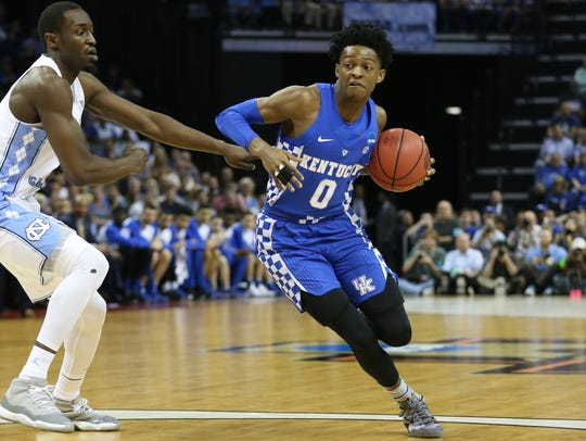 Kentucky guard De'Aaron Fox (right) drives against