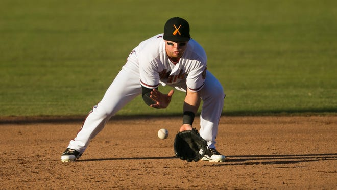 Salt River Rafters third baseman Brandon Drury of the Diamondbacks organization fields a ground ball in the 8th inning against the Peoria Javelinas during a Fall League Championship game at Scottsdale Stadium on Nov. 15, 2014.
