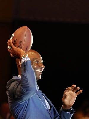 Jerry Rice tosses a football around in the crowd during the Mid-Valley Sports Awards banquet on Tuesday, June 7, 2016, at the Salem Convention Center.