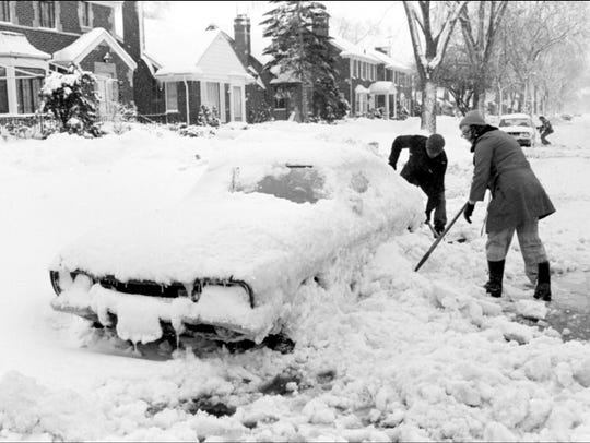 People try to dig out their cars after the blizzard.