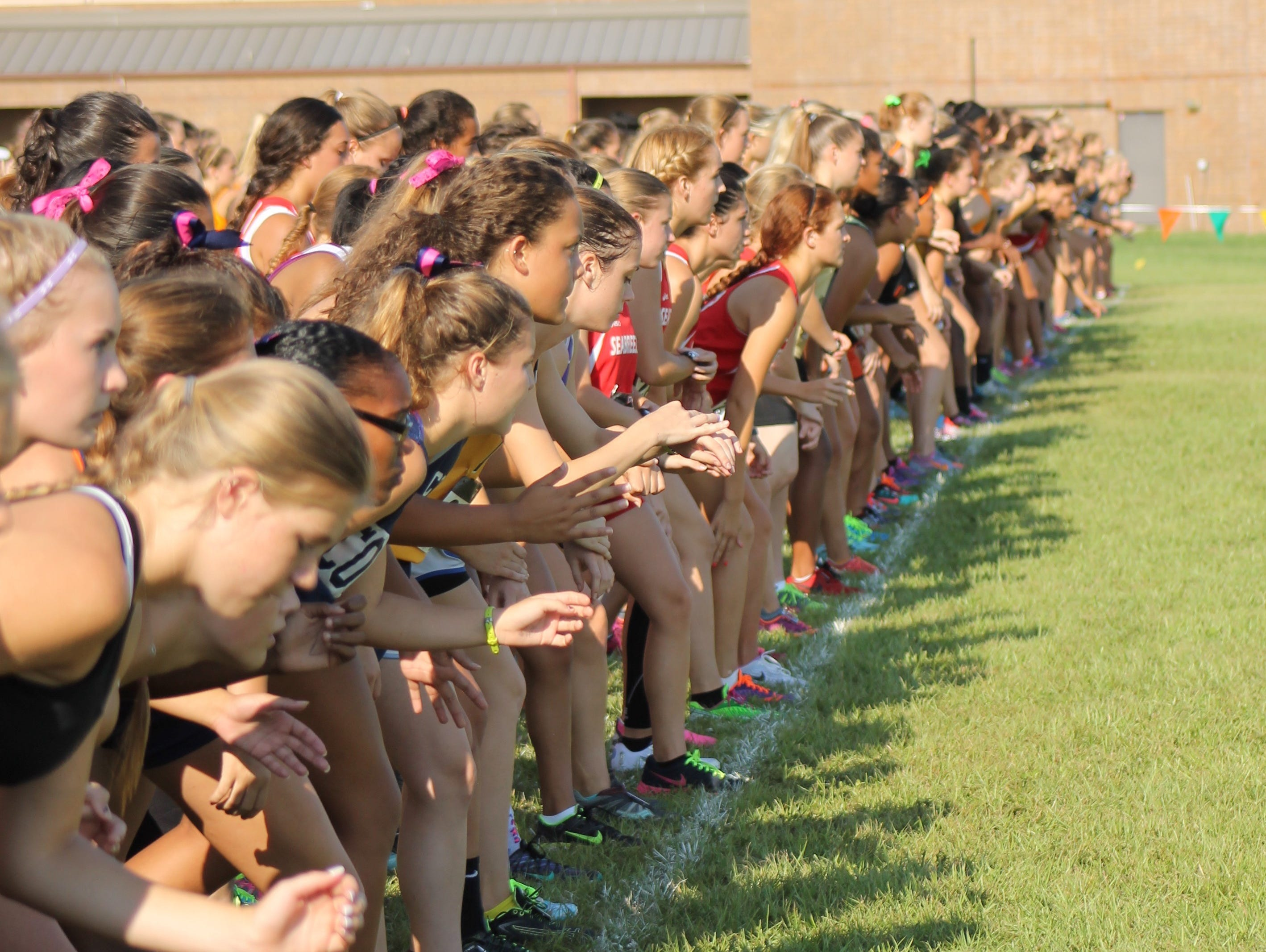 JV girls cross country runners are set and ready at the starting line at the Astronaut Invitational at Chain of Lakes Park in Titusville on Saturday.