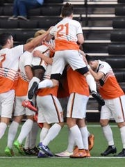 The Michigan Bucks celebrate after a 3-0 victory over the Midland/Odessa Sockers at Pontiac's Ultimate Soccer Arenas.