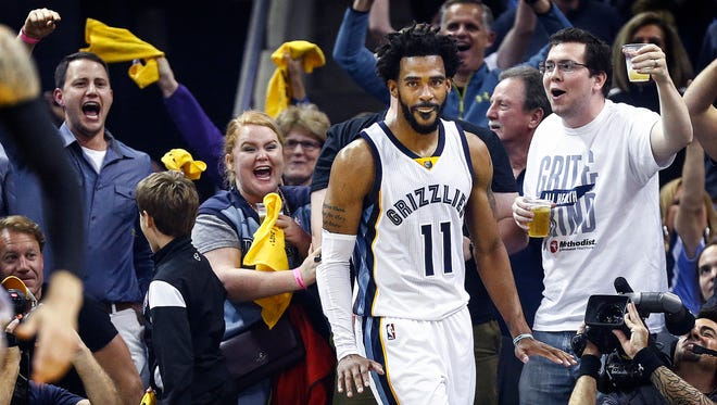 Grizzlies fans celebrate guard Mike Conley's 3-pointer while being fouled by the Spurs during the second quarter of Game 4 on Saturday.