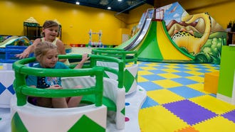Children play following the grand opening of NewTopia Fun Park in Montgomery, Ala. on Wednesday July 18, 2018.