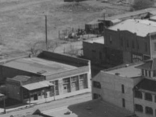 ": A 1930s oblique aerial view shows the ""old Goodwin building"" (left center) that was home to the short-lived Midway Theater, which suddenly closed in May 1909, just nine days after opening."